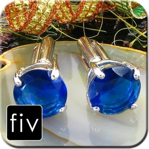 Manžetové knoflíčky stříbrné barvy s modrým kruhovým krystalem